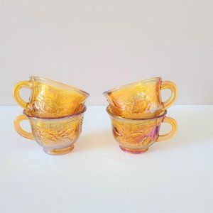 Set of 4 Indiana Marigold Carnival Glass cups.
